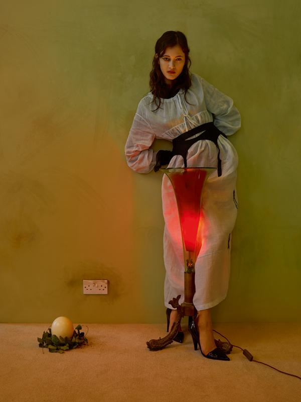 Dress in cotton voile and stilettos,CALVIN KLEIN 205W39NYC. Suspender belt, INTIMISSIMI.