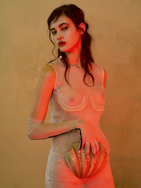 Silk and organza dress embroidered with pearls,MAISON MARGIELA. Gloves, THOMASINE. Earring, MARIE BELTRAMI.