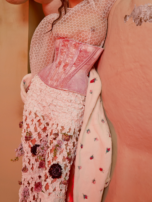 Silk and organza shirt,NOBI TALAI. Satin silk corset, DORHOUT MEES. Cotton smockedtrousers,HYUN MI NIELSEN. Mink coat embroidered MARNI.