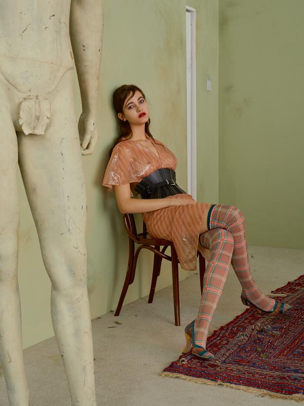 Organza silken dress embellished with sequinsand thigh boots, FENDI. Leather corset, MUGLER.