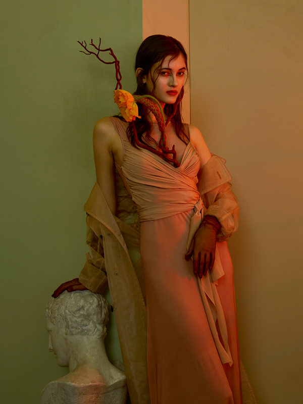Satin silk and cotton wrap-over dress, SANDRO. Silk and organza trenchcoat, MAISON MARGIELA. Gloves, THOMASINE.