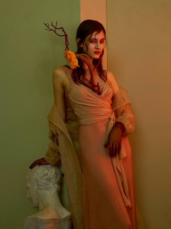Satin silk and cotton wrap-over dress, SANDRO. Silk and organza trenchcoat, MAISON MARGIELA. Gloves, THOMASINE.