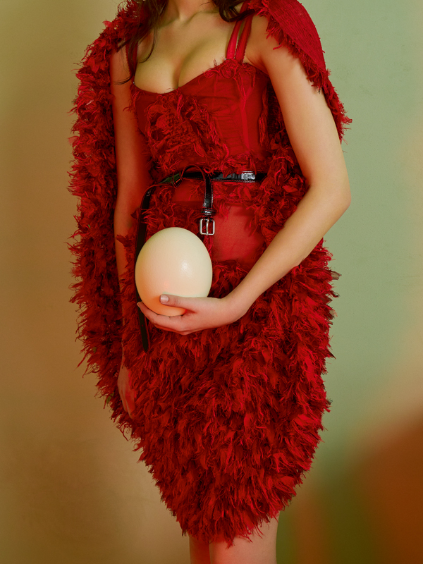 Tweed bustier dress with cut threads and belt, ALEXANDER MCQUEEN.