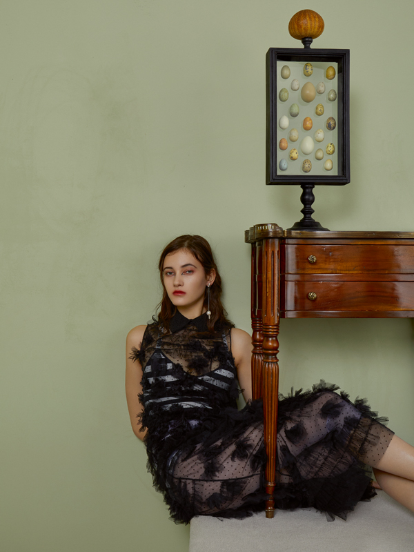 Long tulle dress embroidered andstriped knitted body, DIOR. Earring, MARIE BELTRAMI.