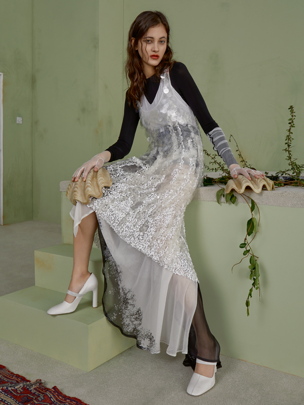 Silk and organza dress embroidered with spangles and python straps,SALVATORE FERRAGAMO. Muslin silk skirt, ANN DEMEULEMEESTER. Gloves, THOMASINE. Shoes, SANTONI.