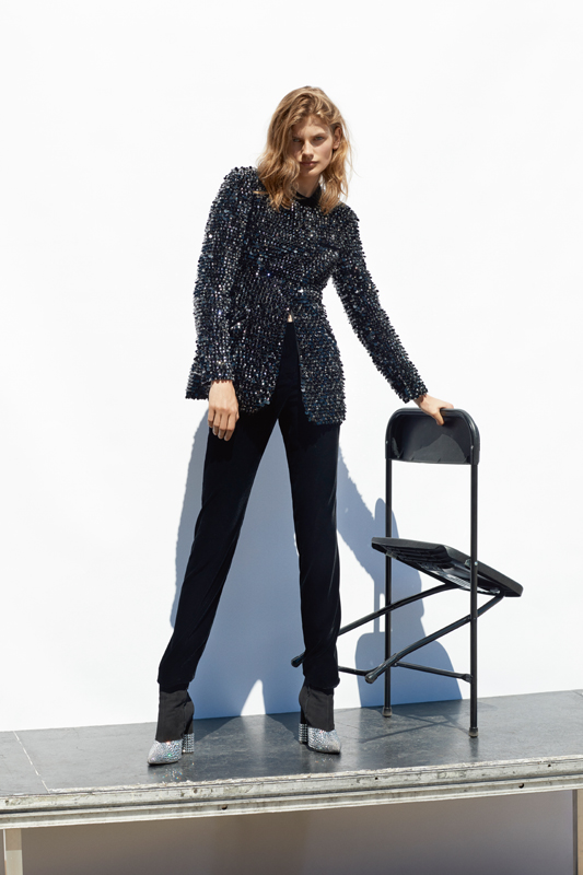 Organza and velvet jacket embroidered with pearls and sequins, and velvet pants, GIORGIO ARMANI. Ankle boots, GIUSEPPE ZANOTTI.