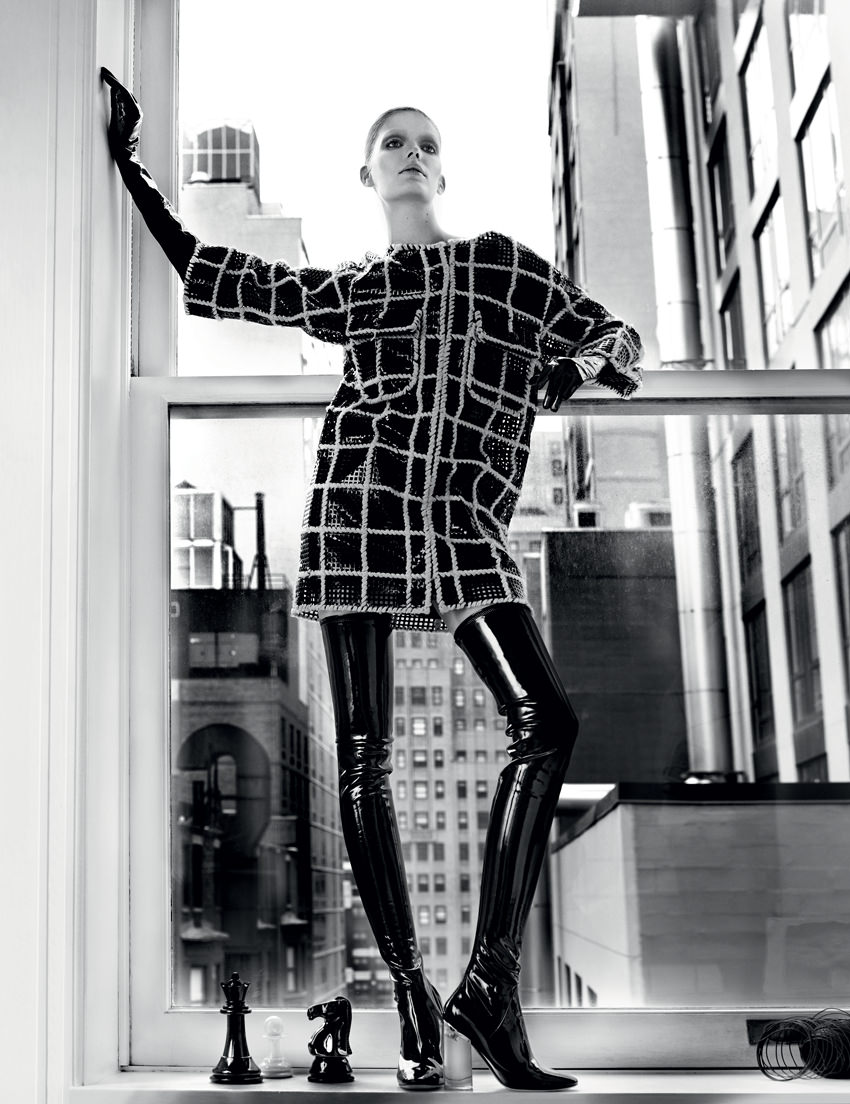 Leather and wool coat, CHANEL. Gloves, LACRASIA.Thigh boots, DIOR.