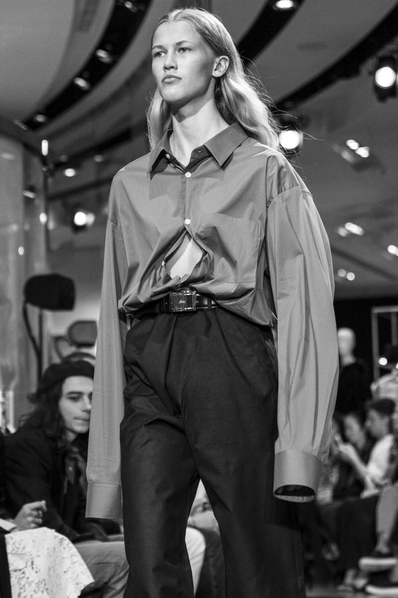 Elaborating on the principles of oversizing and disproportion, their established trademarks, Vetements had the girls walking nude beneath long chiffon dresses stuffed into GMO-nourished thigh boots, so high they were more like waist-high waders with the turned-over tops (in a musketeer style cuff) knocking the models' thighs. These incredible pieces in satin were crafted by a specialist in the field, none other than Manolo Blanhik. The Spanish shoemaker was one of a handful of brands who took part in Vetements' latest daring and innovative concept: a collection entirely based on co-branding. Each in their speciality, Brioni, Perfecto, Schott, Levis, Comme des Garçons Shirt, Reebok, Canada Goose, Dr. Martens, and Juicy Couture had all agreed to make pieces for the Gvasalia brother's label as a sort shock treatment and twisted tribute. An intelligently irreverent approach to appropriation that gives a niche brand diversion strategies of logos and direct quotes from established streetwear brands – a practice the fashion public has yet to fully grasp. Between genius and cynicism, Vetements newest proposal certainly stoked the fires of debate if nothing else.     By Delphine Roche  Photos by Mehdi Mendas   Check out our encounter with Demna Gvasalia. Check out Vetements fall-winter 2016-2017 runway show.​